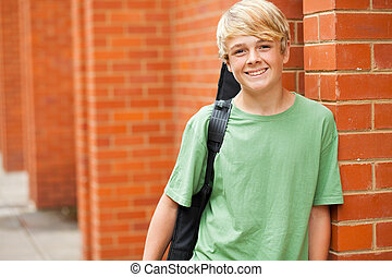 teen musician carrying his guitar - happy male teen musician...