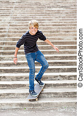 teen boy skateboarding on stairs