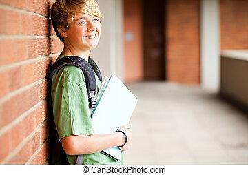 happy middle school boy in school