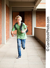 middle school student running - male middle school student...