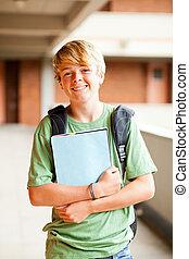 male teen student portrait in school