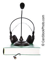 headset with a microphone, hardcover books stack isolated