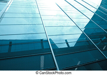glass office building with clouds and sky - modern big city...