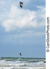 Sea Sport -Kiteboarding - Man is kiteboarding in the ocean