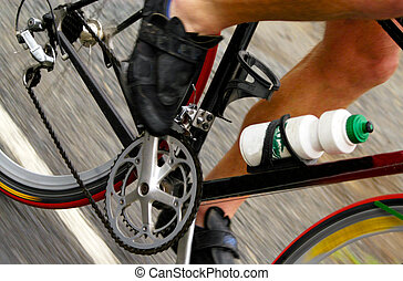 Sport Photos - Cycling - A close-up of legs of a...