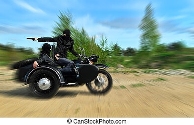 Two armed men riding a motorcycle with a sidecar. Motion...