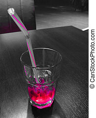 Energizing drink - A pink cocktail in a transparent glass on...