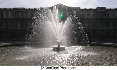 Louvre fountain - Fountain in morning light outside the...