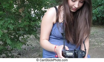 Young beautiful woman with a digital camera - Young brunette...
