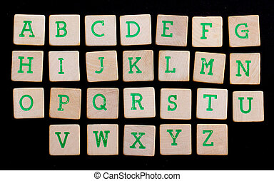Alphabet in letters on old wooden blocks