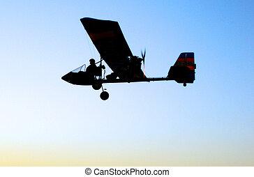 Sport Photos - Ultralight Aviation - A silhouette of...
