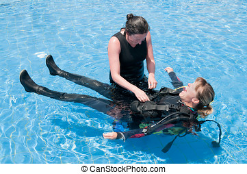 Lady divers - Scuba diving instructor and student having fun...