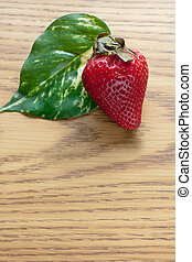 Strawberry One Leaf - Red strawberry green leaf sitting on...