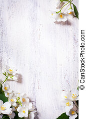 art jasmine spring flowers frame on old wood background -...