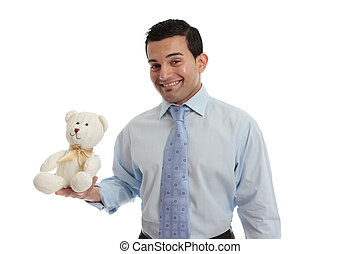 Man holding a knitted teddy bear - Man holding a hand...