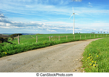 Eco landscape with country road and wind turbine