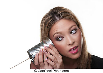 cant hear you - Young woman using a metal tin as a telephone