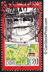 GDR - CIRCA 1981: a stamp printed in GDR shows View and Map...