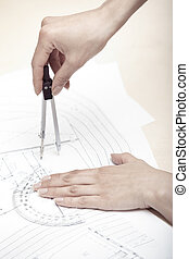 Drawing - Hands of engineer working on a construction plan