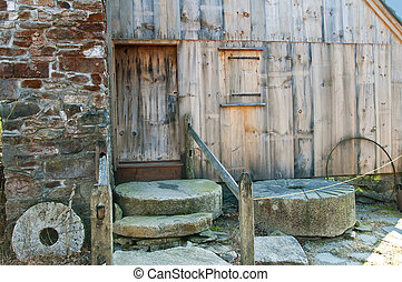 Mill - A collection of old mill stones behind an old...