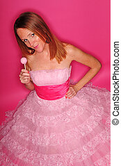 Young woman holding a pink cake pop - Young woman with red...
