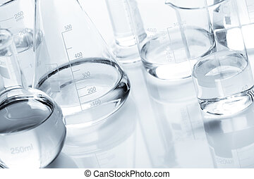 Group of flasks containing liquid over white