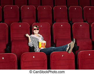 Smiling woman in 3D movie theater