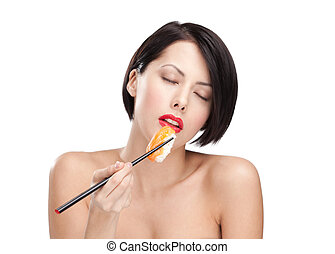 Young attractive woman holding sushi, eyes closed - Young...