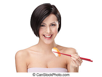 Smiling young female holding sushi with a chopsticks -...