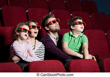Frightened family in 3D movie - Frightened family watching a...
