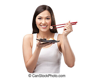 Smiling woman holding sushi roll