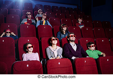 People in 3D movie theater - Smiling people in 3D movie...