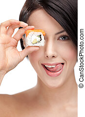 Young girl holding sushi
