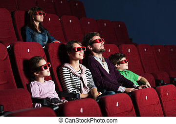 Young family in the movie theater - Young family watching a...