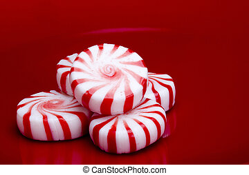 Red Striped Peppermints - Red striped peppermints on a red...