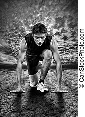 Creative photo of athletes at the start. Black and white.