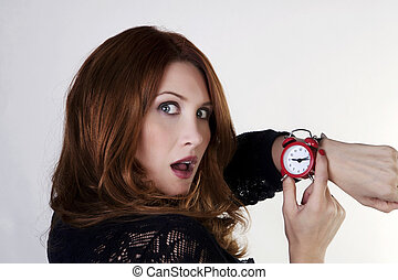 running late - woman looking at watch who running late
