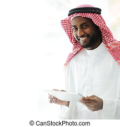 Arabic executive person using tablet at office