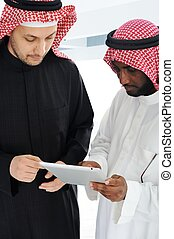 Business people planning work in office working on tablet computer