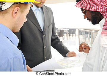 Architects at Middle east discussing engineering design...