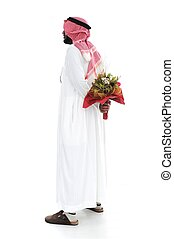 Middle eastern man hides behind a roses for his wife