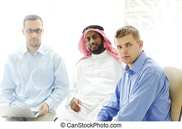 Multicultural different ethnic group working on laptop together