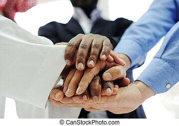 Business team overlapping hands