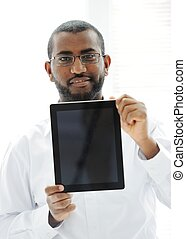 African man holding tablet ready for your message