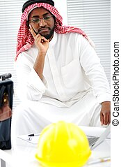 Arabic engineer having a concern about the plans