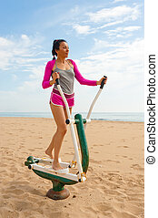 Outoor fitness machine - An outdoor fitness machine on a...