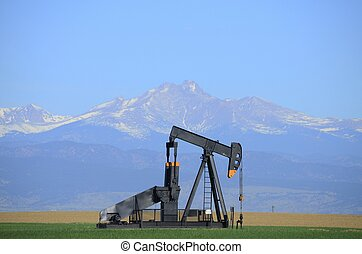 Oil Well - Pump jack oil well with Long's Peak
