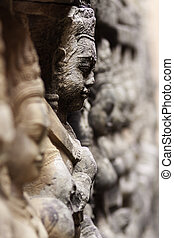 Ancient stone sculpture in Angkor Wat. Cambodia. - Detail of...