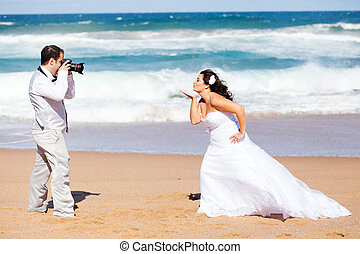 groom taking bride's photo
