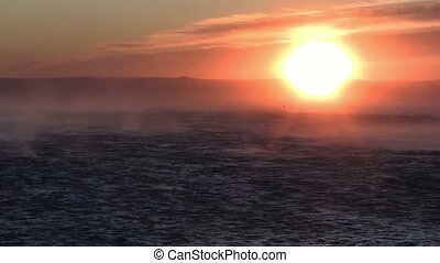 Hurricane wind at sunset - Strong hurricane wind on sea at...